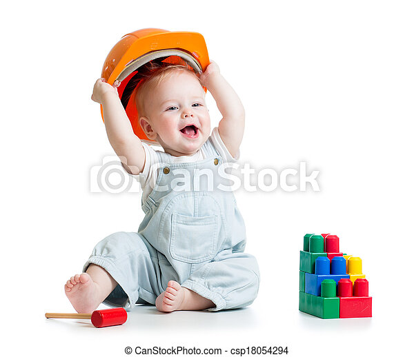 kid playing with building blocks toy - csp18054294