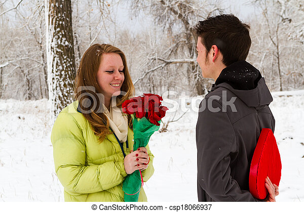 Stock Photos of Valentines Day - Teenager boy with Valentines Day gifts for...