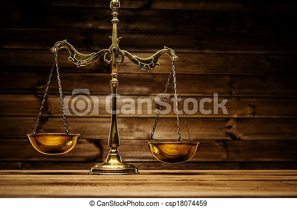 Brass scales over wooden background  - csp18074459