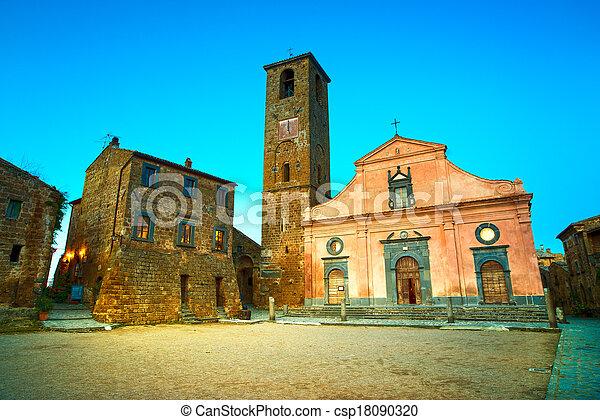 Civita di Bagnoregio ghost town landmark, medieval village square and church view on twilight. Lazio, Italy, Europe. - csp18090320