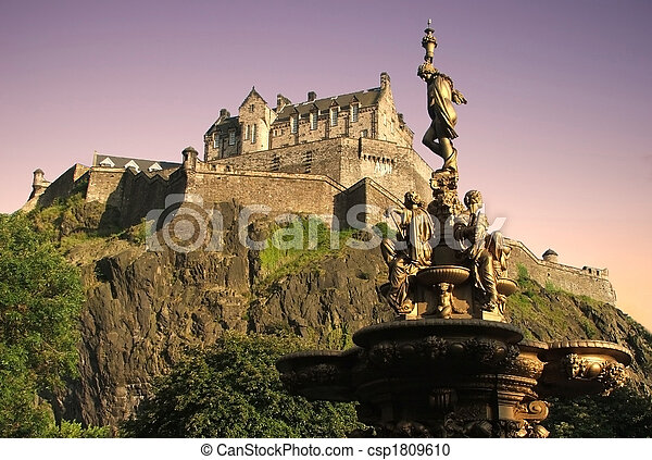 Edinburgh Castle, World Heritage Site, as viewed from Princes Street Gardens at sunset.