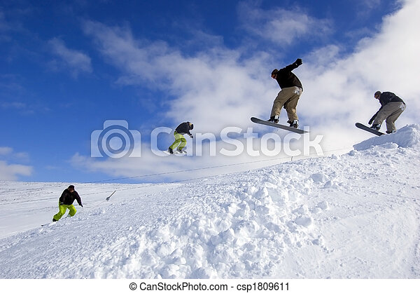 Snowboarders mid-air - csp1809611