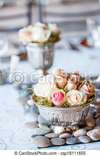 Beautiful bouquet of roses at wedding reception - csp18111655