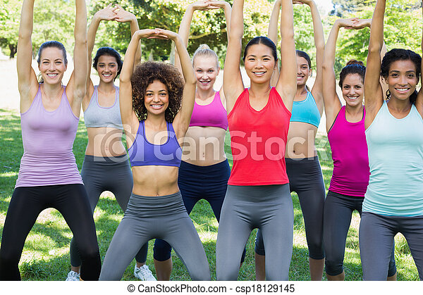 Sporty women stretching at park - csp18129145