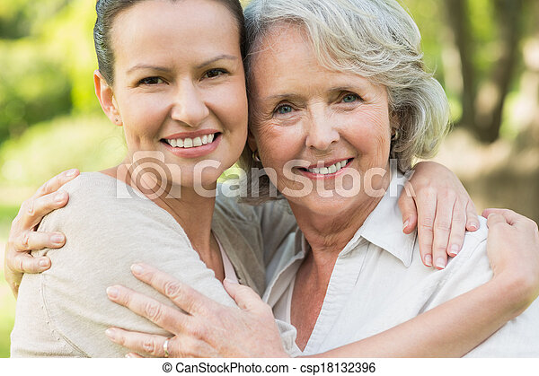 Smiling mature woman with adult daughter - csp18132396
