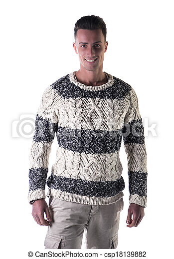 Good looking young man standing, wearing winter sweater - csp18139882