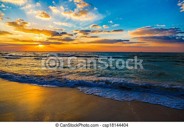 Dubai sea and beach, beautiful sunset at the beach - csp18144404