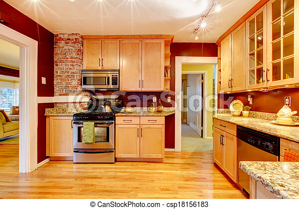 Bright kitchen room with brick designed wall - csp18156183