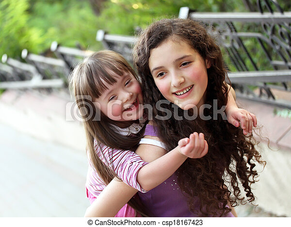Happy girls in the park. - csp18167423