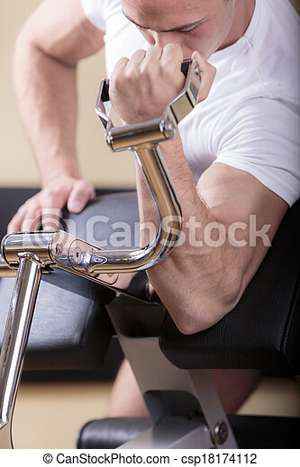Young man training in the gym - csp18174112
