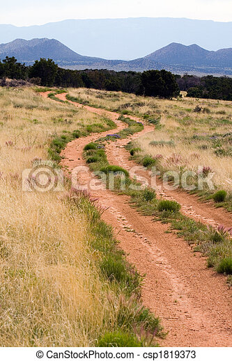 Dirt road mountain scene - csp1819373