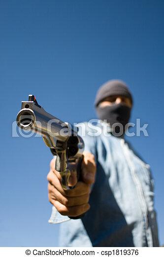 Hooded man 44 magnum handgun - csp1819376