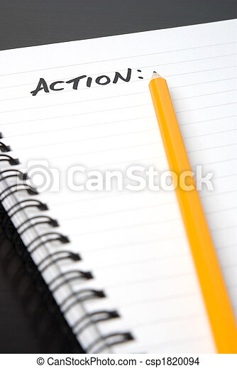 writing ACTION in a spiral-bound notebook. - csp1820094