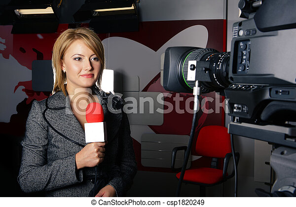 attractive television news reporter and video camera - csp1820249