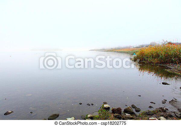 Lake with smog at morning - csp18202775
