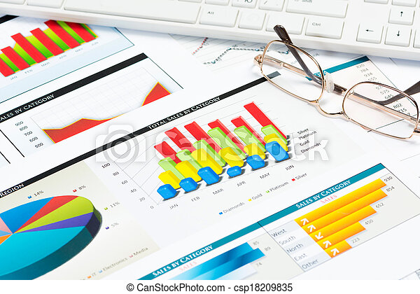 glasses, business papers with charts - csp18209835