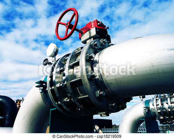 Industrial zone, Steel pipelines and valves against blue sky - csp18219509