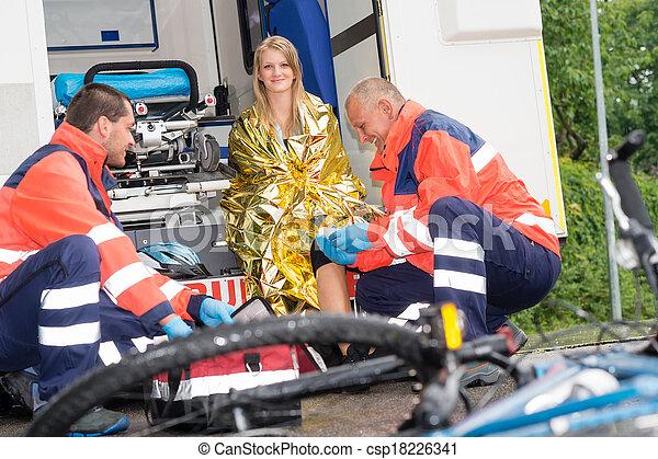 Bike accident woman emergency doctor bandage leg - csp18226341