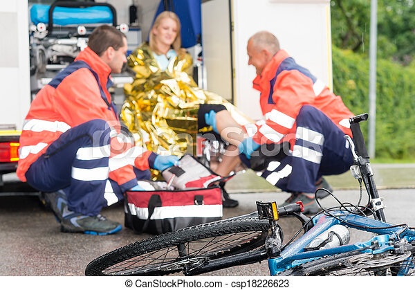 Accident bike woman get emergency help paramedics - csp18226623