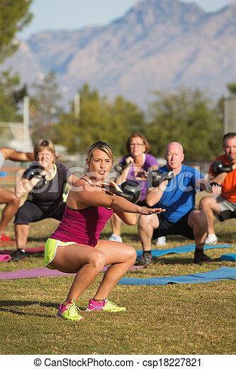 Adults Exercising Near Mountains - csp18227821