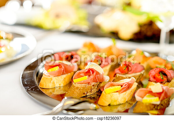 Catering canapes tray food details appetizers - csp18236097