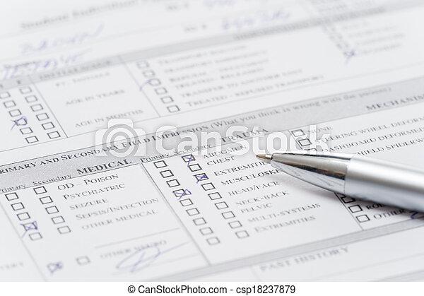 Filling up emergency medical form document - csp18237879