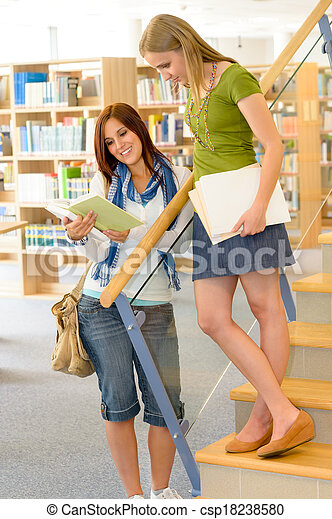 High school library students with books - csp18238580