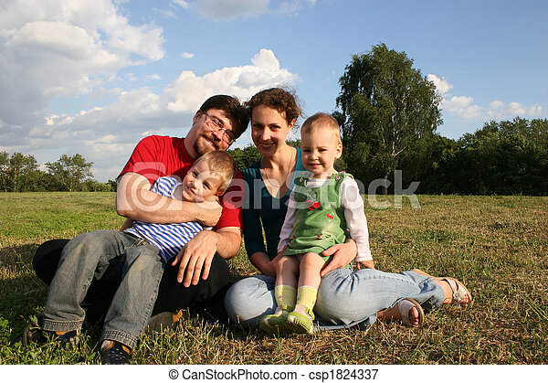 family with two children sit on meadow and trees 2 - csp1824337