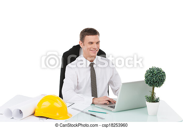 handsome male smiling and typing at computer. adult engineer sitting on stool at work - csp18253960