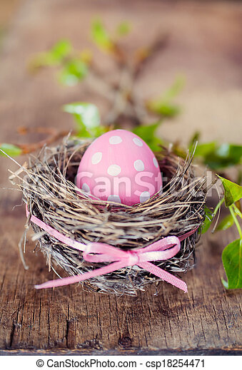 Pink easter egg in nest - csp18254471
