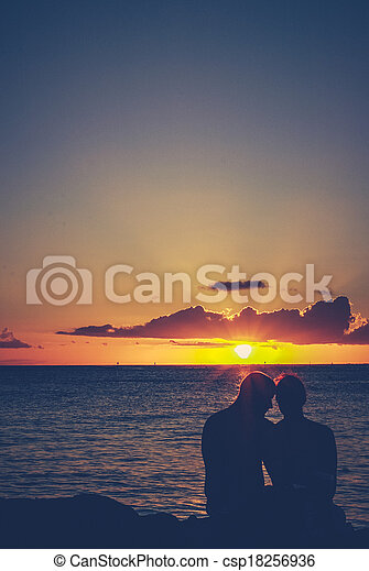 Retro Embracing Sunset Couple - csp18256936