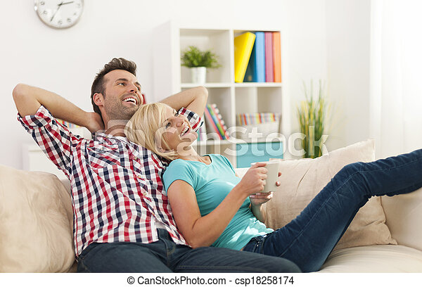 Happy couple relaxing together at home - csp18258174