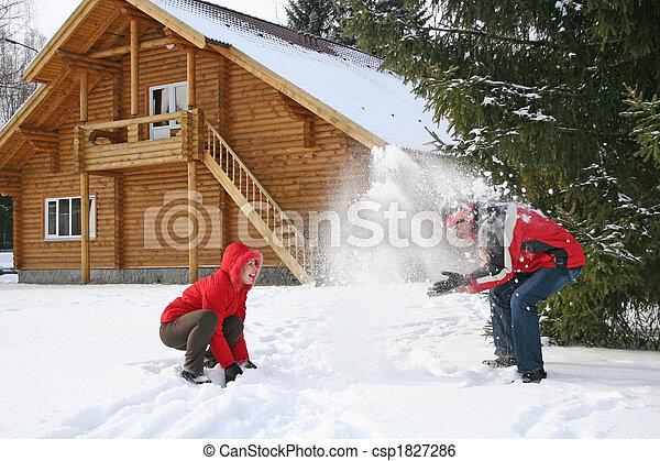 couple winter house throw snow - csp1827286