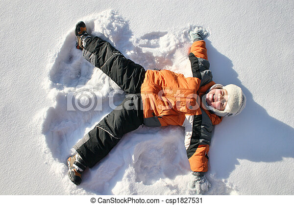 boy lies on north pole snow - csp1827531