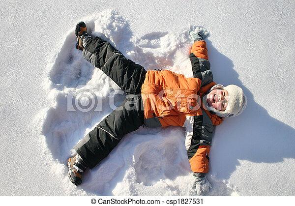 boy lies on north pole snow - csp1827531