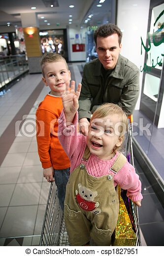 father with children in shop - csp1827951