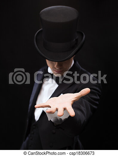 magician holding something on palm of his hand - csp18306673