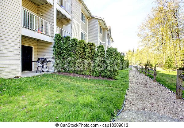 Backyard patio area. Residential community house. - csp18309013