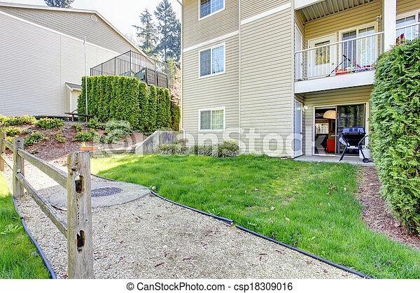 Backyard patio area. Residential community house. - csp18309016