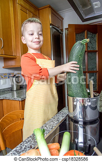 Cute child chef cooking big zucchini in a pot