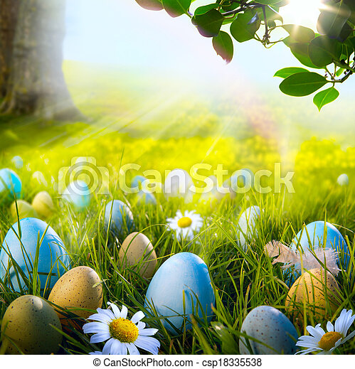 Art decorated easter eggs in the grass with daisies  - csp18335538