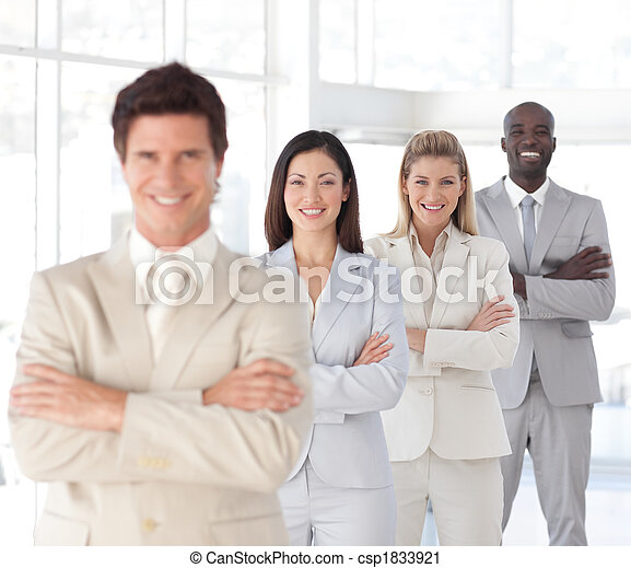 Business man with arms folded in front of Business Team  - csp1833921