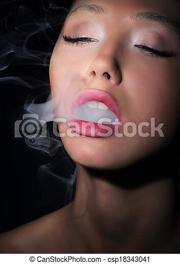 Dependence. Addiction. Woman Smoker Exhales Smoke of Cigarette - csp18343041