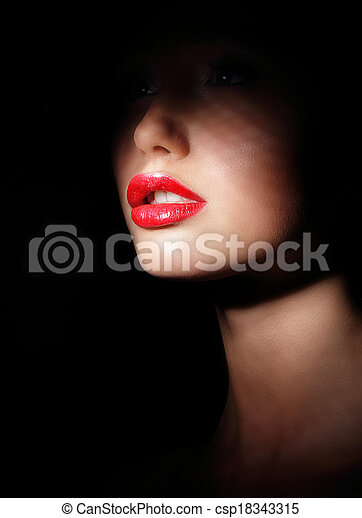 Stock Photo - Darkness. Woman's Face with Sexy Red Lips in Spotlight ...