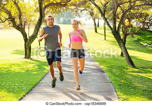 Couple running together in the park - csp18346699