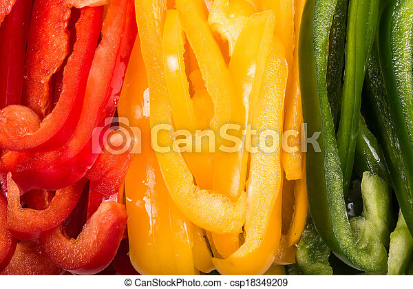 sliced ??red, yellow and green Bell Peppers  - csp18349209