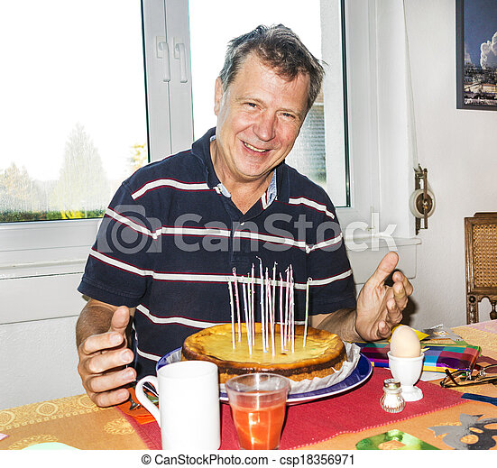 decorated birthday table with candles in the birthday cake