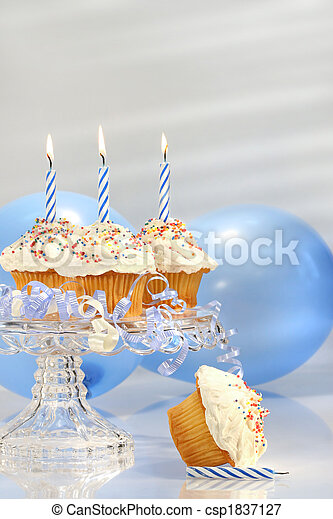 Birthday cupcakes with blue candles - csp1837127