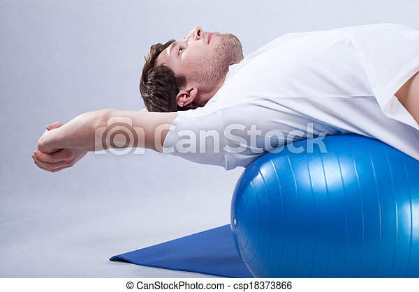 Rehabilitation stretching on ball - csp18373866