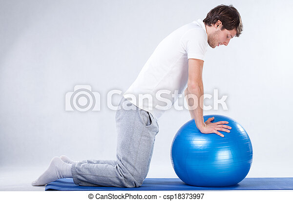 Rehabilitation exercises on fitness ball - csp18373997